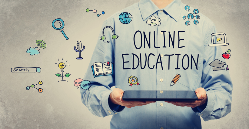 Online Education concept with young man holding a tablet computer